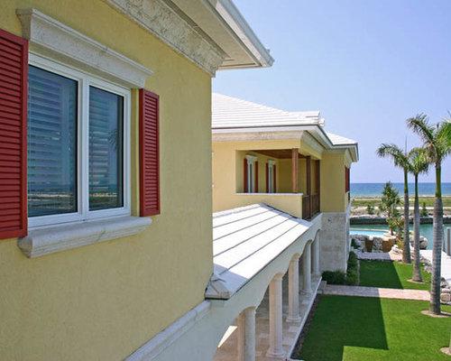 Tropical two tone paint exterior home design ideas remodels photos - Average cost to paint exterior house trim decor ...