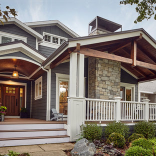 Mid-sized arts and crafts blue two-story wood gable roof photo in Chicago