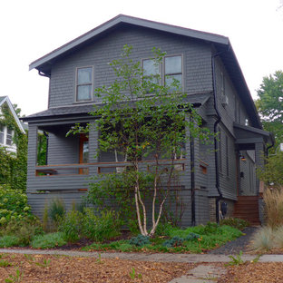Mid-sized farmhouse gray two-story concrete fiberboard exterior home idea in Other with a shingle roof