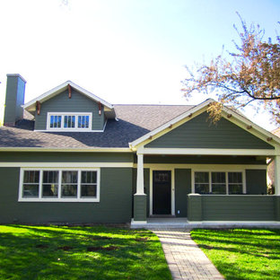Example of a mid-sized minimalist green two-story concrete fiberboard exterior home design in Other with a shingle roof