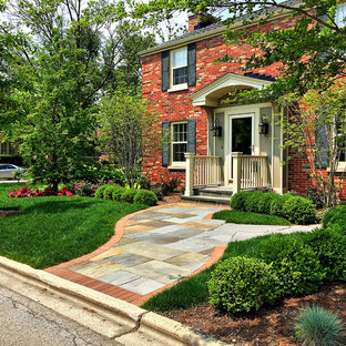 Inspiration for a small timeless red two-story brick exterior home remodel in Chicago