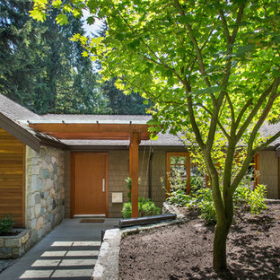 Inspiration for a contemporary exterior in Vancouver with wood siding.