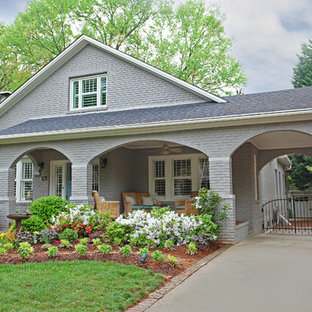Inspiration for a craftsman gray two-story brick exterior home remodel in Charlotte
