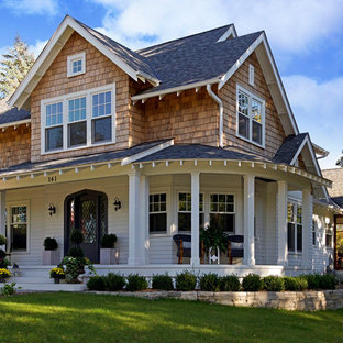 Example of a large cottage chic brown two-story mixed siding exterior home design in Minneapolis