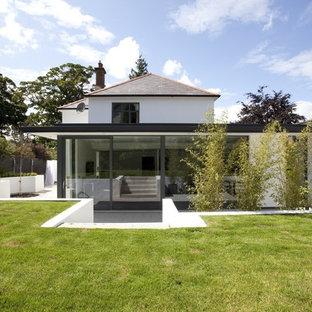 Inspiration for a contemporary render exterior in Dublin.