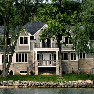 Elegant stone exterior home photo in Chicago