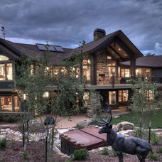 Rustic Exterior by Aneka Interiors Inc.