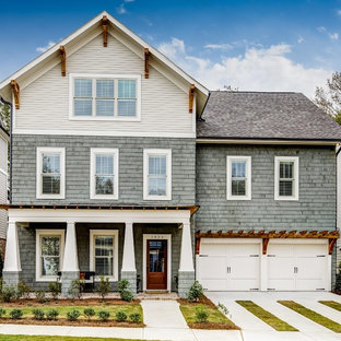 Large elegant gray three-story mixed siding gable roof photo in Atlanta
