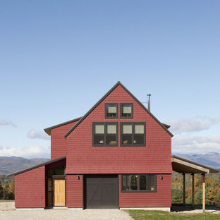Inspiration for a medium sized and red country two floor exterior in Portland Maine with wood cladding.