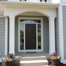 Traditional Exterior by Berghuis Construction LLC