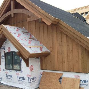 デンバーのおしゃれな家の外観 (混合材サイディング、茶色い外壁、混合材屋根) の写真