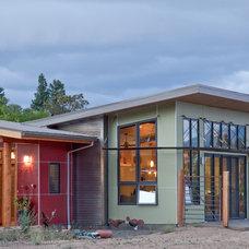 Eclectic Exterior by Carlos Delgado Architect