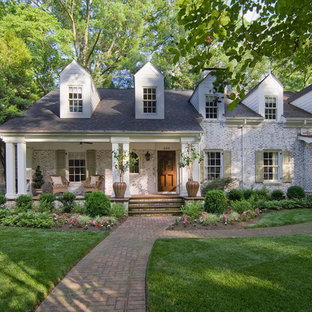 Mid-sized traditional white two-story brick exterior home idea in Charlotte