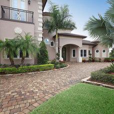Tropical Exterior by Christopher Burton Homes, Inc.