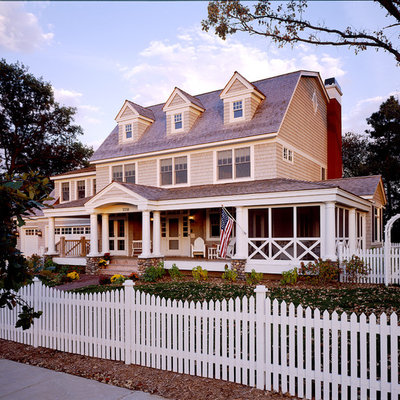 Inspiration for a mid-sized victorian three-story wood exterior home remodel in Minneapolis