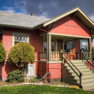 This is an example of a small arts and crafts one-storey red exterior in Seattle with wood siding.