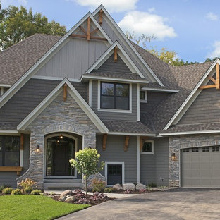 Example of a large transitional gray two-story mixed siding exterior home design in Minneapolis