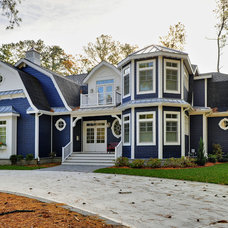 Beach Style Exterior by Echelon Custom Homes
