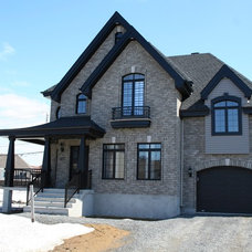 Traditional Exterior by Merkley Supply