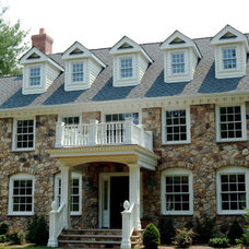 Traditional Exterior by Camelot Custom Building