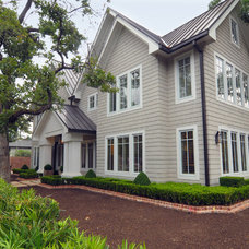 Traditional Exterior by Greymark Construction Company