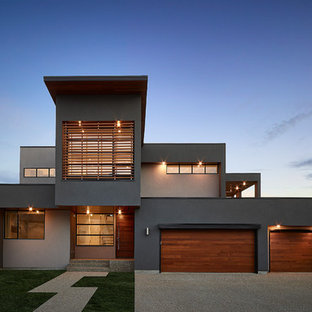 Inspiration for a contemporary gray two-story exterior home remodel in Edmonton
