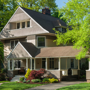 Inspiration for a large victorian beige three-story wood gable roof remodel in New York
