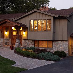 Traditional stone exterior home idea in Minneapolis