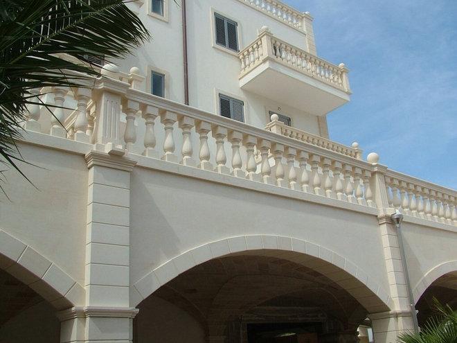 Mediterranean Exterior by Marvelous Marble Design Inc.