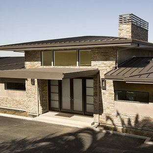 Inspiration for a contemporary one-story exterior home remodel in San Francisco with a metal roof