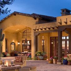 Mediterranean Exterior by Mooney Design Group, Inc.