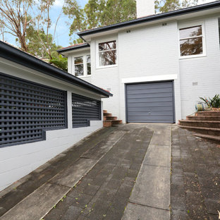 Mid-sized transitional gray two-story brick gable roof photo in Sydney