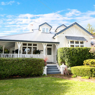 Inspiration for a mid-sized timeless beige two-story brick gable roof remodel in Sydney