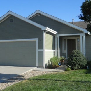 Small elegant green one-story concrete fiberboard exterior home photo in Denver with a shingle roof