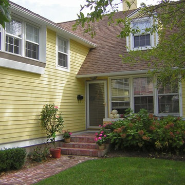 Exterior Painting - Yellow and White Cottage House in Cape May, NJ
