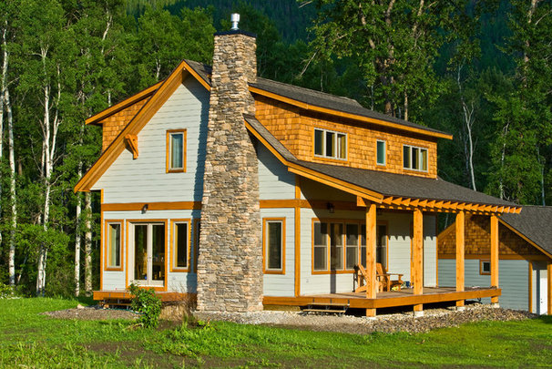 Eclectic Exterior by Sticks and Stones Design Group inc.