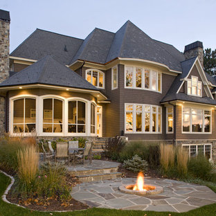 Example of a large classic three-story wood exterior home design in Minneapolis