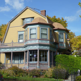 Victorian yellow two-story wood exterior home idea in Providence