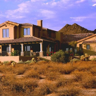 Example of a southwest beige two-story adobe exterior home design in Phoenix