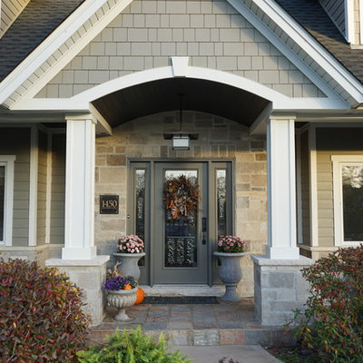 Large traditional gray two-story mixed siding gable roof idea in Chicago