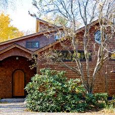 Rustic Exterior by Perkins Smith Design Build