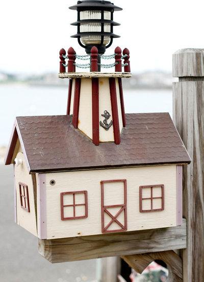 Beach Style Exterior by Rikki Snyder
