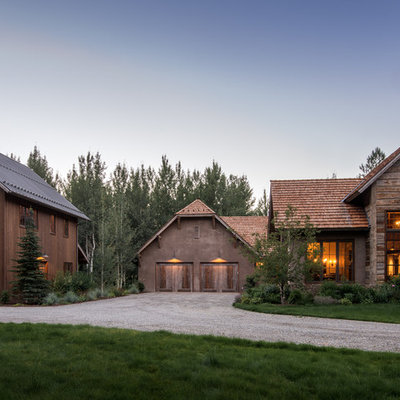 Inspiration for a large rustic brown two-story wood gable roof remodel in Other