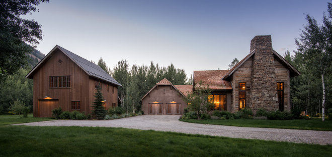 Rustic Exterior by Miller Architects LTD