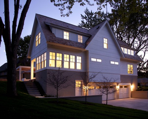 design ideas for a contemporary exterior in minneapolis with wood siding and a gable roof