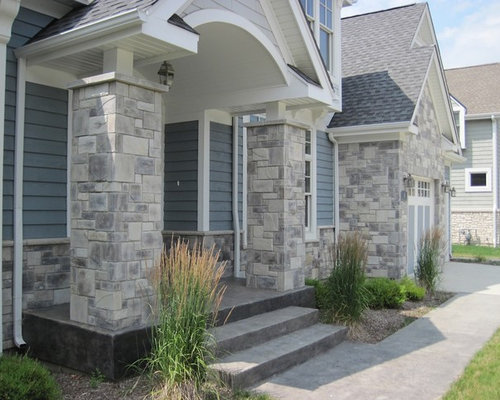 Stone and hardie board houzz for Stone exterior house designs