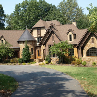 Huge craftsman brown three-story stone exterior home idea in Charlotte