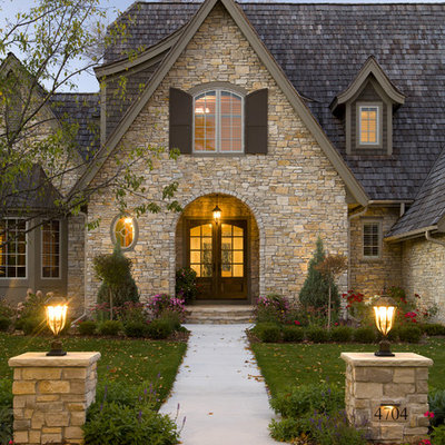 Traditional two-story stone exterior home idea in Minneapolis