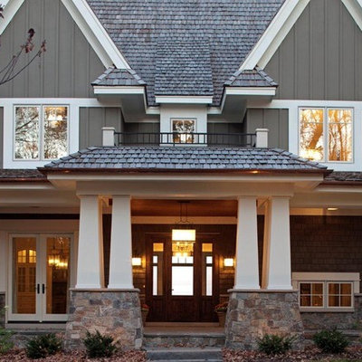 Example of an arts and crafts wood exterior home design in Minneapolis
