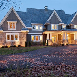 Inspiration for an arts and crafts exterior in Minneapolis with wood siding and a gable roof.